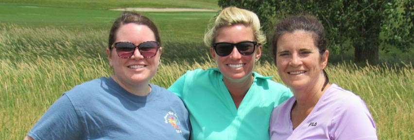 Three golfers at the Annual Golf Outing Fundraiser.