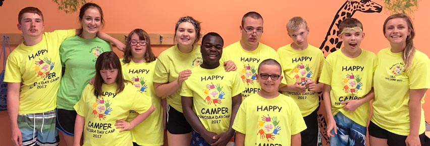Camp Independence posing for a picture at their camp site in the Romeoville Recreation Center.