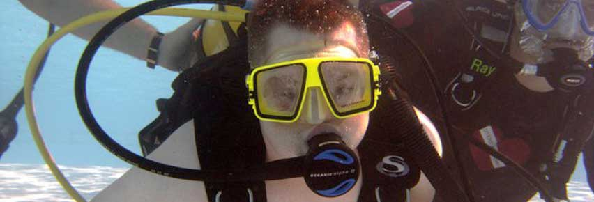 Participant having a great time underwater at our Discover Scuba program.